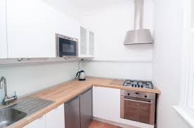 Small white kitchens with white appliances White Colored Cozy White Kitchen In Condo With Wood Countertops And Stainless Steel Appliances This Has Everything Kitchen Cabinets And Bathroom Vanities Showroom Open Late Evenings 50 Small Kitchen Ideas dont Overthink Compact Design