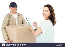 Happy Delivery Man Giving Package To Customer Stock Photo