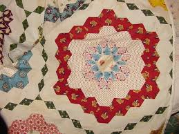 Quilt Pattern names - Antique Quilt History & Chintz quilt, c1830, made in an arrangement of hexagons and diamonds. See  full quilt above. Adamdwight.com