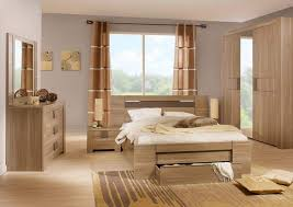 small bedroom design with oak wood bed and furniture sets