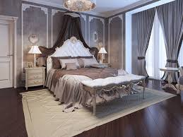this luxurious master bedroom has a very victorian art deco theme to it the walls are a grey color with the white trim the flooring is a gorgeous dark