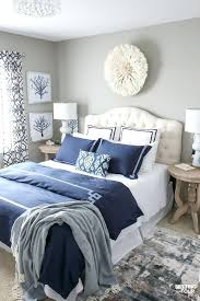 blue and white wall decor see my new guest bedroom updates including this gorgeous white hat