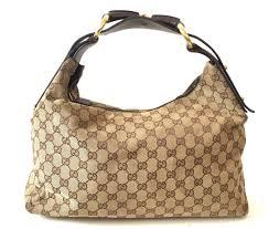 gucci used. gucci monogram canvas signature gg shoulder bag | gently used - secret stash m