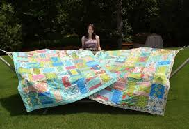 Five Fast Quilting Projects, Patterns & Techniques & Smiling Woman Showing off Two Quilts on Hammock Adamdwight.com