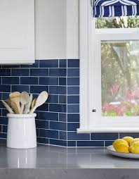 Love the preppy look of this sapphire blue subway tile paired with white.