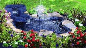 a simple bright blue garden pond with a tall center fountain small enough to fit