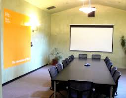 elegant office conference room design wooden. Interior. Long Brown Wooden Table With Black Chairs On The Floor Feat White Screen Elegant Office Conference Room Design