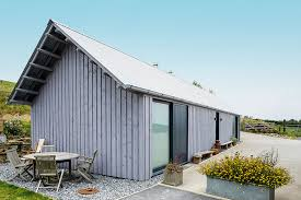 contemporary barn style self build home with timber cladding
