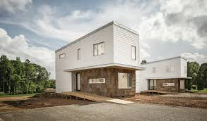designing an energy efficient home. the neighboring prefab houses in south boston, va., look identical, but designing an energy efficient home