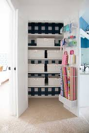 how to organize a linen closet blue and white linen closet with white baskets