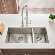 undermount kitchen sinks stainless steel. QUICKVIEW. DISCONTINUED. Pekoe Collection. 35x18 Offset Double Bowl Stainless Steel Kitchen Sink. 18CR9351800 Undermount Sinks 1