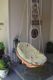 diy swing chair repurposed wicker chair turned into swing i made this swing from a 20 00 thrift find after removing the legs and re wrapping the
