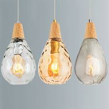 glass light wood glass lighting hand