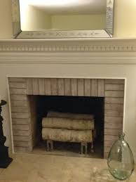 over the holidays when catching up on blog reading one of the blogs i love mentioned painting the inside of the fireplace black i had wondered if this was