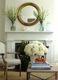 mirror over fireplace living room with recycled glass bottles and round wood convex mirror above fireplace mirror over fireplace