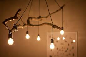 natural tree branch and string light chandelier wood lamps pendant lighting