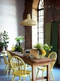 love the wooden farm table yellow chairs