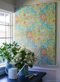 make easy diy art with a canvas stretcher frame and pretty fabric within diy fabric wall