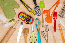 colorful kitchen utensils. Colorful Kitchen Utensils On Wooden Background Stock Photo - 48133910