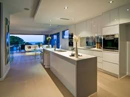 Kitchen Inspiration: Open Plan Kitchen Dining Area With White High Gloss  Cabinets That Reflect The Light. Narrow And Long Island