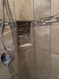 ceramic tile shower walls with custom niche accented with glass and stone mix ceramic tile shower wall with glass stone mix accent liner