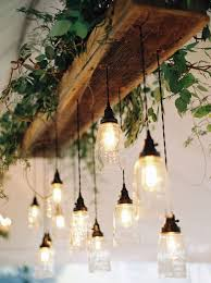 rustic interior lighting. natural glam wedding in lavender and green light installation pastels rustic interior lighting o