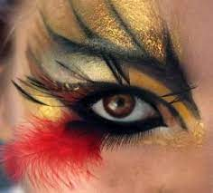 Dramatic stylized makeup with fun feather accent. by yvette | Bird makeup,  Dramatic makeup, Fire makeup