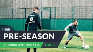 pre season for football running with the ball drills
