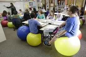 teachers ditch student desk chairs for yoga