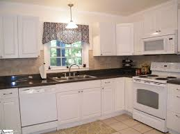 Limestone Floors In Kitchen Traditional Kitchen With Raised Panel Pendant Light In