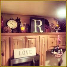 decorating above kitchen cabinets with greenery large size of kitchen above kitchen cabinets should you decorate decorating above kitchen cabinets