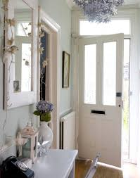 Pale Green Hallway With Silver Floral Chandelier ...