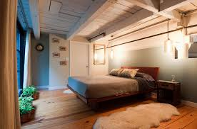classic white wooden ceiling over floating master wooden bed frame added white fur rug as well as pendant bedroom lighting as decorate vintage master loft