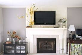 hanging tv above fireplace beautiful adorable how to hide tv wires over brick fireplace best