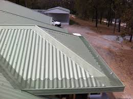 corrugated metal roof 22 with corrugated metal roof