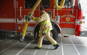 Firefighters focus on clean air, bodies and gear to try to cut ...