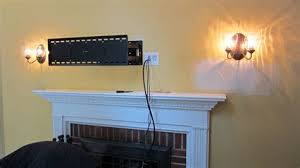 hiding wires for wall mounted tv over fireplace 4 top