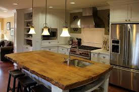 rustic wood countertops kitchen traditional with backsplash breakfast bar built in image by madson