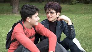 communication skills in high school ways to help teens improve mother and teen son sitting and talking in a park