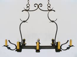 eight light iron chandelier with flat bar scroll work shown with medium base sockets includes antique paper board candle covers