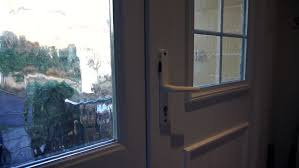 house front door open. Man Leaving House Through Front Door. Door Open And Closed. A PVC With 5 Lever Mortice Deadlock System For Security Safety.