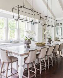 white cabinets and a rustic wood topped center island are the perfect mix in this kitchen designed by castle custom homes the clean lines of the double