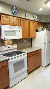 Oak Cabinets Stained Dark Painted White Design Ideas Honey With Black  Granite Countertops. Oak Cabinets Grey Backsplash Honey Stained Darker Dark  Pictures.