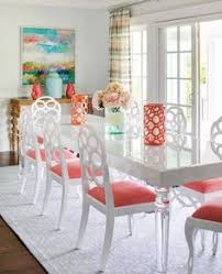 vibrant dining room design featuring white lacquer lucite and bungalow 5 loop chairs