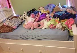 Bed wih Stuffed Animals