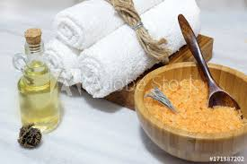 preparation for the spa procedure orange bath salt in a wooden bowl and spoon