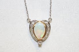 two tone opal and diamond pendant
