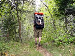 backng with a pack wheel strapped on a jansport external frame backpack