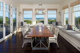 beach style dining room with ample relaxation space from anderson studio of architecture