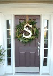 front door wreathPlease Take That Fall Wreath Down  Hooked on Houses